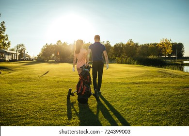 Shot of a retired couple standing on a golf green.