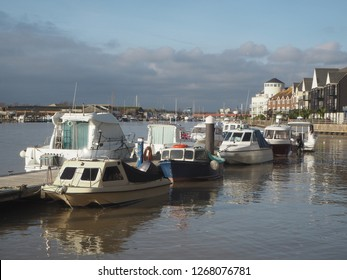 A shot of the River Arun at Littlehampton in West Sussex, England.  The photo was taken looking north, towards the South Downs and shows pleasure and fishing boats moored along the river bank.