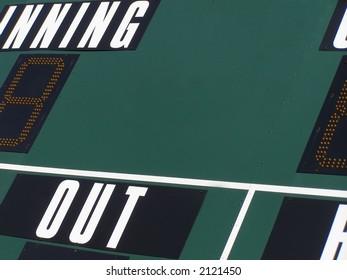 Shot of scoreboard above baseball diamond.