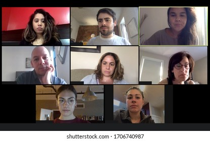 Shot of a screen of teammates doing a virtual conference from their home offices.  Team meeting from home during COVID-19 coronavirus pandemic.