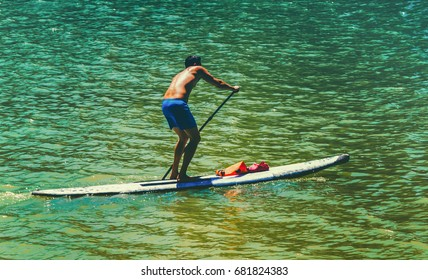shot in seville , spain ,a man is corssing the river and practising the kayak sport