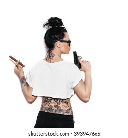 Shot of a sexy swag woman posing with gun and cigar.  White background, not isolated
