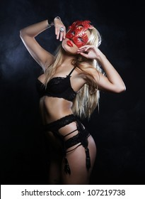 Shot of a sexy woman in erotic lingerie with mask