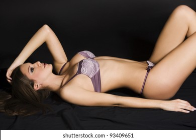 Shot of a sexy woman in lingerie over black background