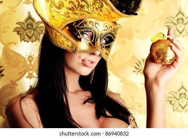 Shot of a sexy woman in a mask over vintage background.