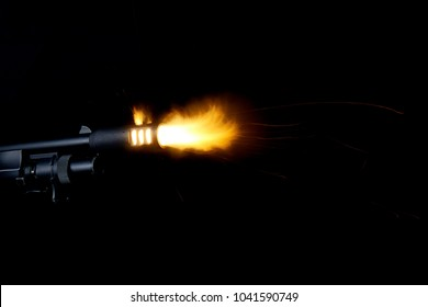 Shot of shotgun with muzzle flash