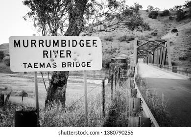 A shot up sign near a bridge in rural NSW