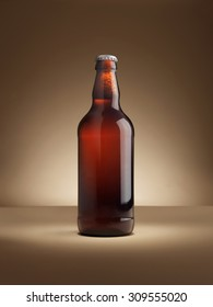 shot of a single bottle of real ale on a coloured background lit with in a halo, vignette style with copy space for the designer. Background is natural, lighting with no post production adjustments.
