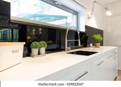 Shot of a sink in a modern spacious kitchen