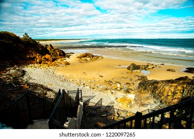 A shot of the small strip of beach located on the rocky coastline of the Ogunquit River along the Maine coast.
