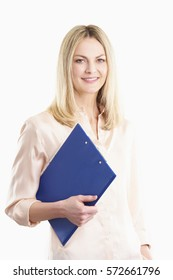 Shot of a smiling middle aged woman holding clipboard in her hands while standing at isolated white background.