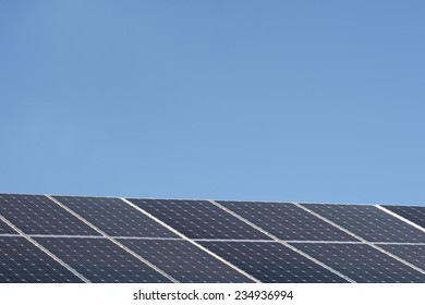 A shot of solar panels of a tiled roof