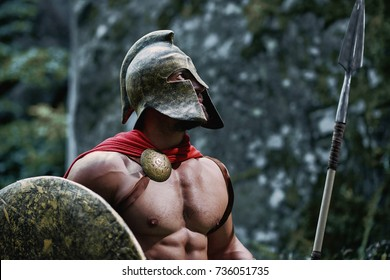 Shot of a Spartan warrior wearing a helmet looking around in the woods.