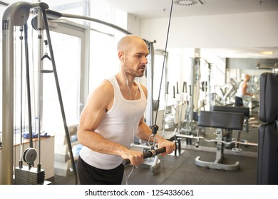Shot of sporty man doing exercises in gym.