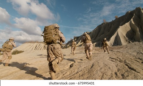 Shot of Squad of Soldiers Running Forward and Atacking Enemy During Military Operation in the Desert.