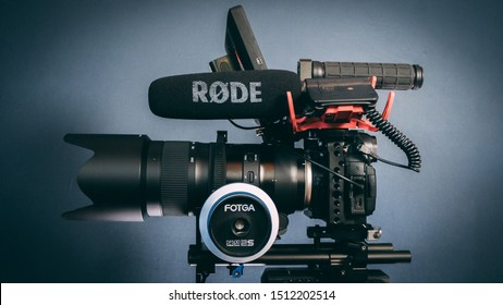 Shot in studio (Netherlands) on September 22, 2019: Panasonic GH5 4K Camera filmmakers rig. Dslr on a tripod rigged with Fotga follow focus and rode microphone.