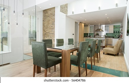 Shot of a Stunning Modern Luxury Interior of Dining Area with Open Plan Kitchen