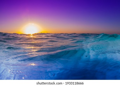 A shot of the sun rising over the Caribbean sea with the camera held very low to the water to catch the cool effect