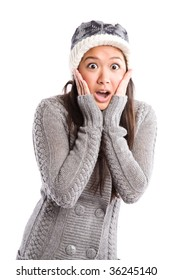 A shot of a surprised beautiful asian woman in winter outfit