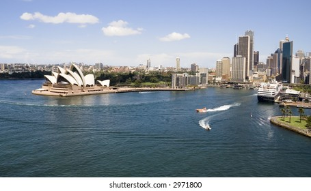 Shot of the Sydney including the Sydney Opera House and a cruise ship in port