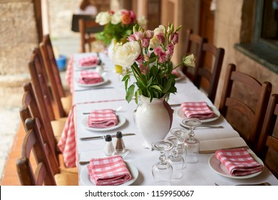 Shot of a table set for a meal at the restaurant with outdoor terrace.