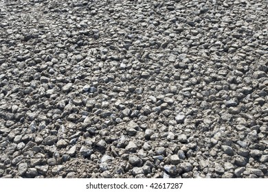 a shot take in the process of the construction of a road. Gravel surface used for asphalt.