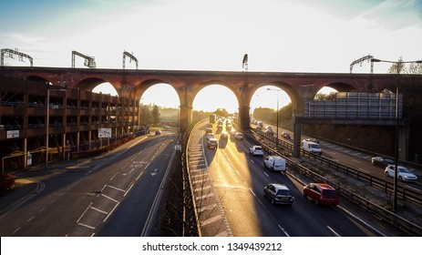 Shot taken off a bridge, shows the motorway through Stockport and famous viaducts.