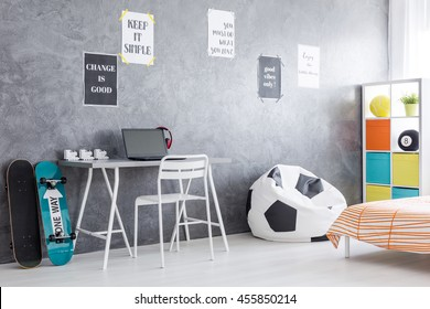Shot of a teenage room interior with a place for work and sleeping area