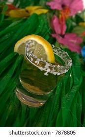 Shot of tequila on a grass skirt
