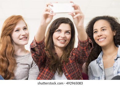 Shot of three pretty young women taking a selfie