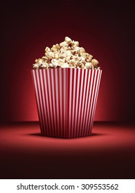 Shot of a traditional box of cinema style popcorn with spotlighting on a vibrant red background with copy space for the designer.