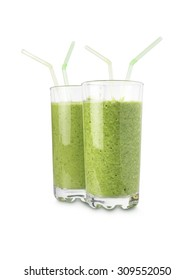 shot of two glasses with green, fruit smoothies isolated on a white background with copy space for the designer.