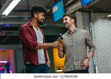 Shot of two man cheering with beer