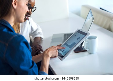 Shot of two pretty young business women working together with digital tablet in the office.