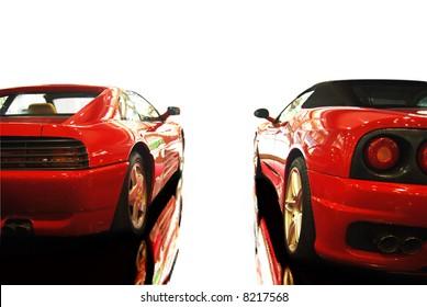 shot  of a two red sports cars (ferrari)