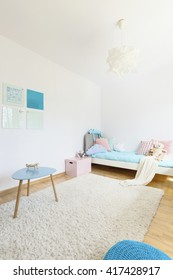 Shot of a very bright and peaceful bedroom with white fluffy carpet, bed filled with soft toys and glass writing boards