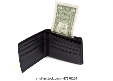 Shot of a wallet that is almost empty. Only one dollar left.