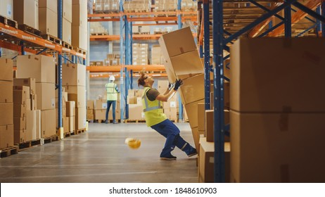 Shot of a Warehouse Worker Has Work Related Accident. He is Falling Down BeforeTrying to Pick Up Heavy Cardboard Box from the Shelf. Hard Injury at Work.