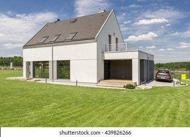 Shot of a white single-family detached house