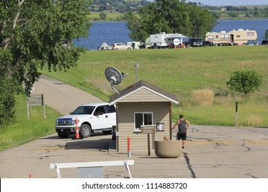 A shot of Wilson Lake in Kansas south of Lucas Kansas USA with the Toll Booth that you buy tickets at with grass,trees,and Campers. On 5-26-2018.