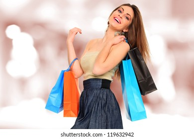 A shot of a woman with bags shopping