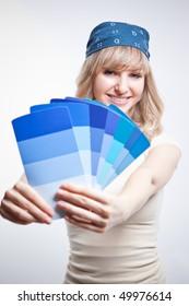 A shot of a woman choosing paint colors