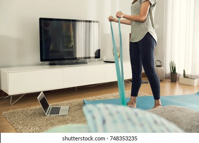 Shot of a woman doing exercise at home