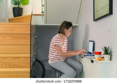 Shot of a woman working from home