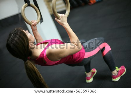 A shot of a woman working out in the gym.