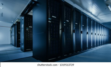 Shot of a Working Data Center With Rows of Rack Servers. Led Lights Blinking and Computers are Working.