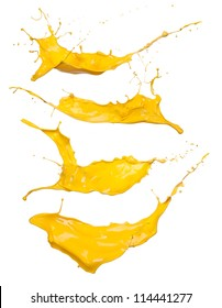 Shot of yellow paint splashes, isolated on white background
