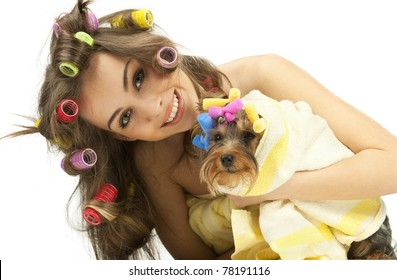Shot of young adult female with Yorkshire Terrier dog after shower