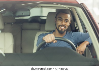 Shot of a young attractive man smiling happily sitting in a new automobile copyspace driving owner insurance car sales retail buyer buying comfort lifestyle travelling safety insurance offer discount