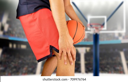 shot of a young basketball player with an inflamed knee at stadium